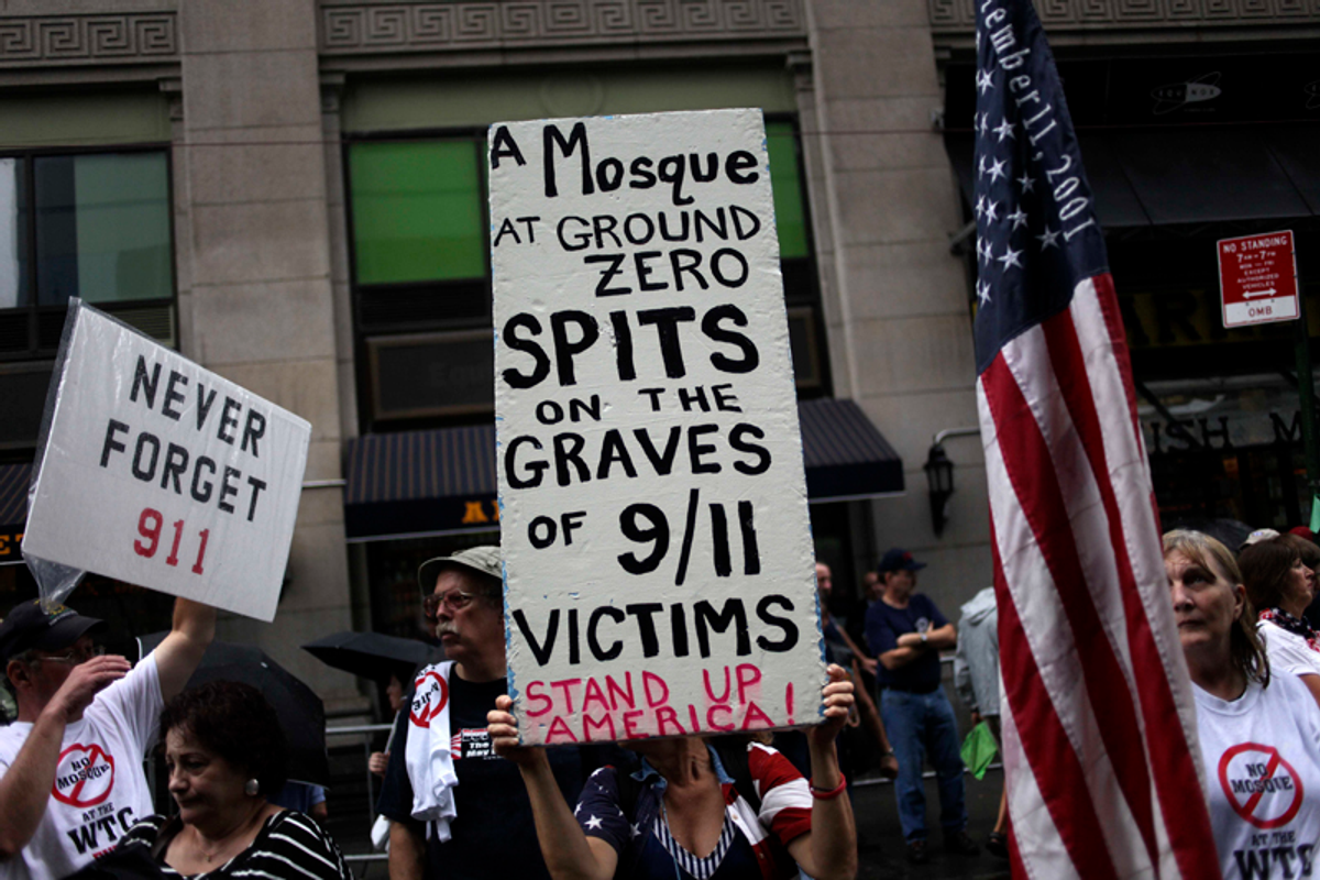 People participate in a rally against a proposed mosque and community center near ground zero in New York, Sunday, Aug. 22, 2010