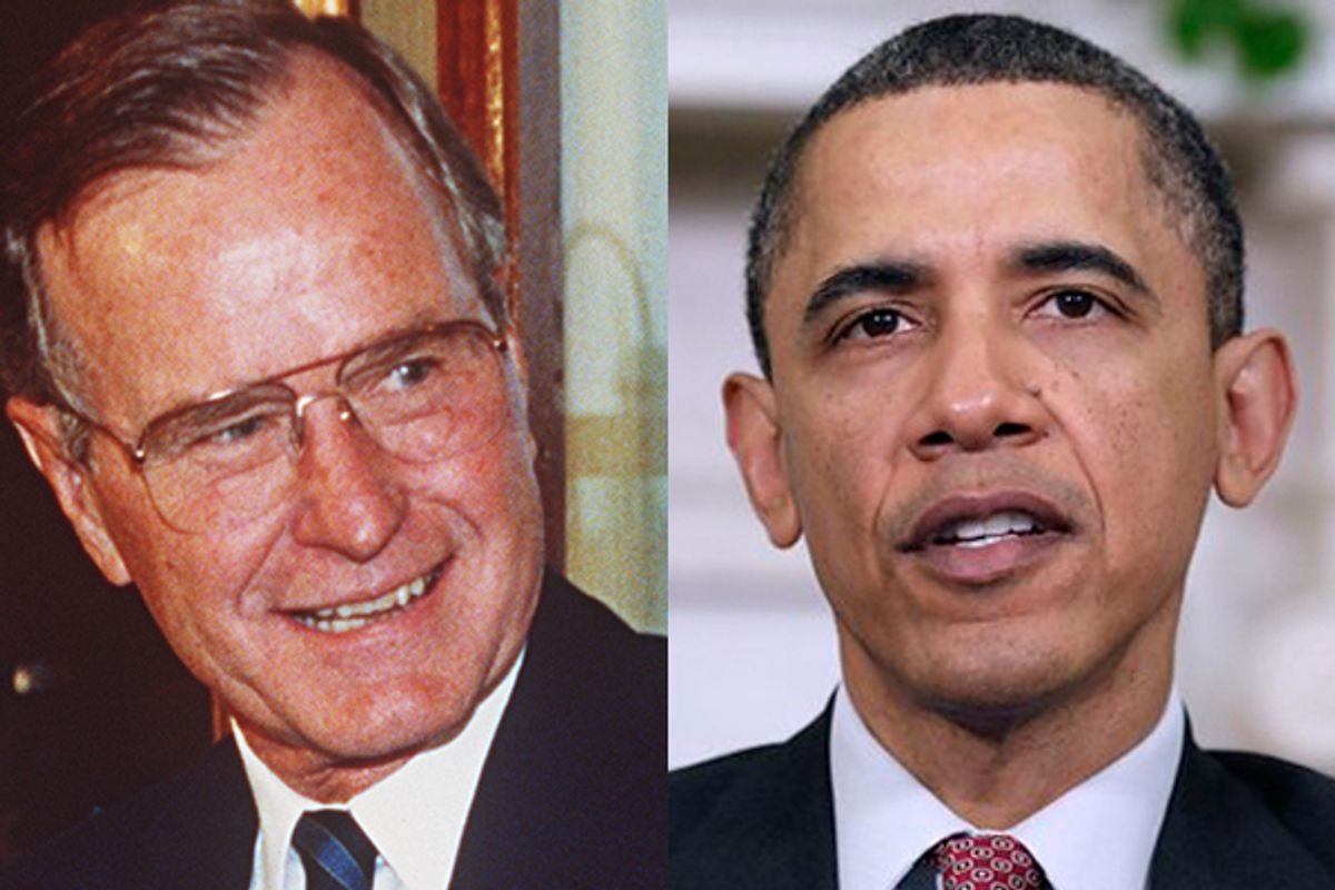 Former president George H. W. Bush and President Barack Obama