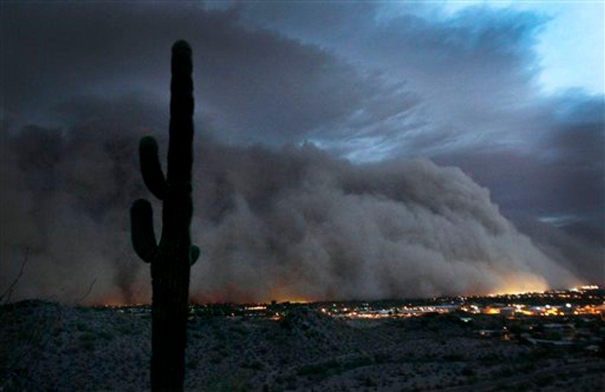 A giant dust storm covers Phoenix, Ariz., Tuesday, July 5, 2011. (AP Photo/The Arizona Republic, Rob Schumacher) (AP)