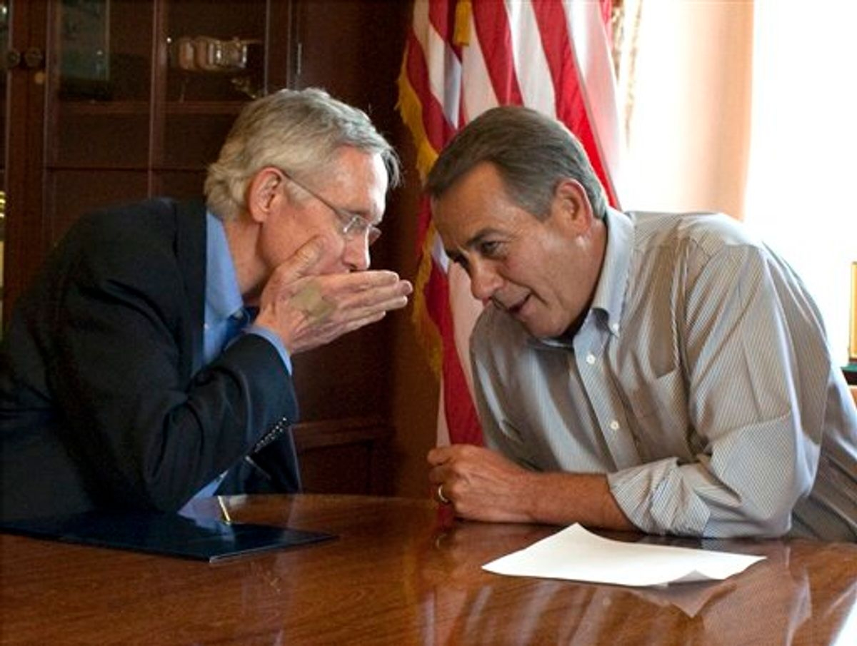 Senate Majority Leader Harry Reid, D-Nev., holds his hand up as he whispers to House Speaker John Boehner, R-Ohio,  during a photo opportunity in the House Speaker's office before a meeting on the debt limit increase on Capitol Hill in Washington on Saturday, July 23, 2011.(AP Photo/Harry Hamburg) (AP)