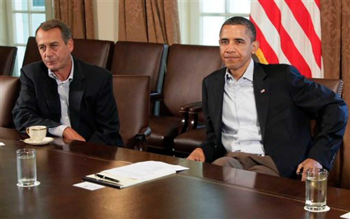 President Barack Obama sits next to House Speaker John Boehner of Ohio, left, in the Cabinet Room of the White House, Saturday, July 23, 2011, in Washington, as they meet to discuss the debt. (AP Photo/Carolyn Kaster)  (AP)