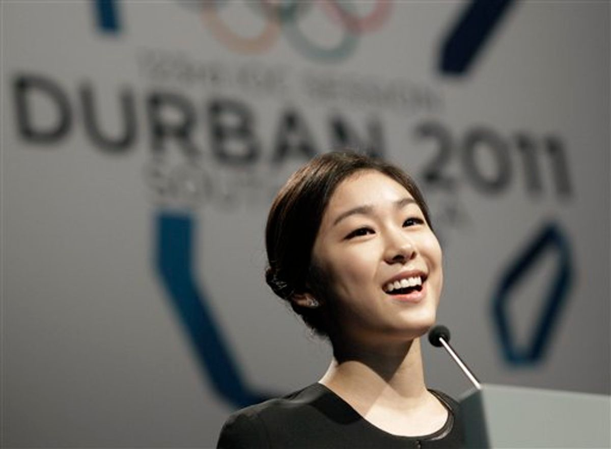 South Korea's figure skater and Olympic champion Kim Yu-na  during the presentation of the  Pyeongchang bid , in front of the 123rd International Olympic Committee (IOC) session that will decide the host city for the 2018 Olympics Winter Game, in Durban, South Africa, Wednesday July 6, 2011. The International Olympic Committee will announce the host city for the 2018 Winter Olympics in Durban, Wednesday, choosing between three candidates Annecy, France; Munich Germany; and Pyeongchang, South Korea for the 2018 host. (AP Photo/Rogan Ward, Pool) (AP)