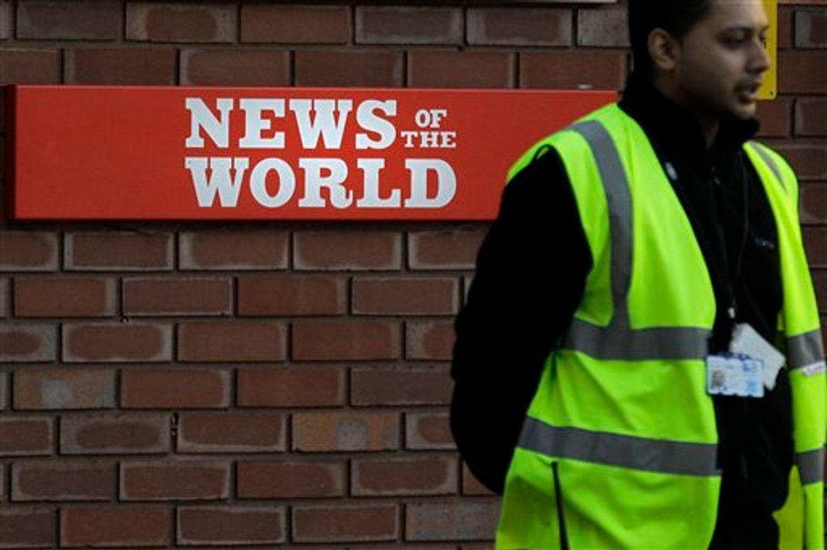A security officer stands at the gates outside the publisher of News of the World, News International's headquarters in London, Thursday, July 7, 2011.  Sunday newspaper News of the World is accused of hacking into the mobile phones of crime victims, celebrities and politicians, prompting News International to announce Thursday that the papers is to cease publication after publication upcoming Sunday. (AP Photo/Sang Tan) (AP)