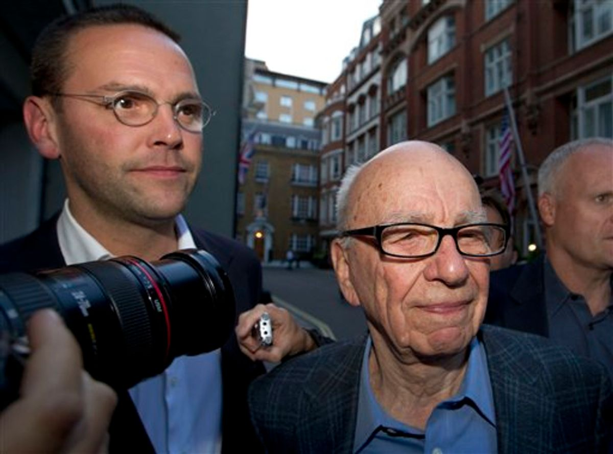 Chairman of News Corporation Rupert Murdoch, right, and his son James Murdoch, chief executive of News Corporation Europe and Asia arrive at his residence in central London, Sunday, July 10, 2011. News of the World cease publication with Sunday issue the last. News of the World is accused of hacking into the mobile phones of crime victims, celebrities and politicians. (AP Photo/Sang Tan)  (AP)