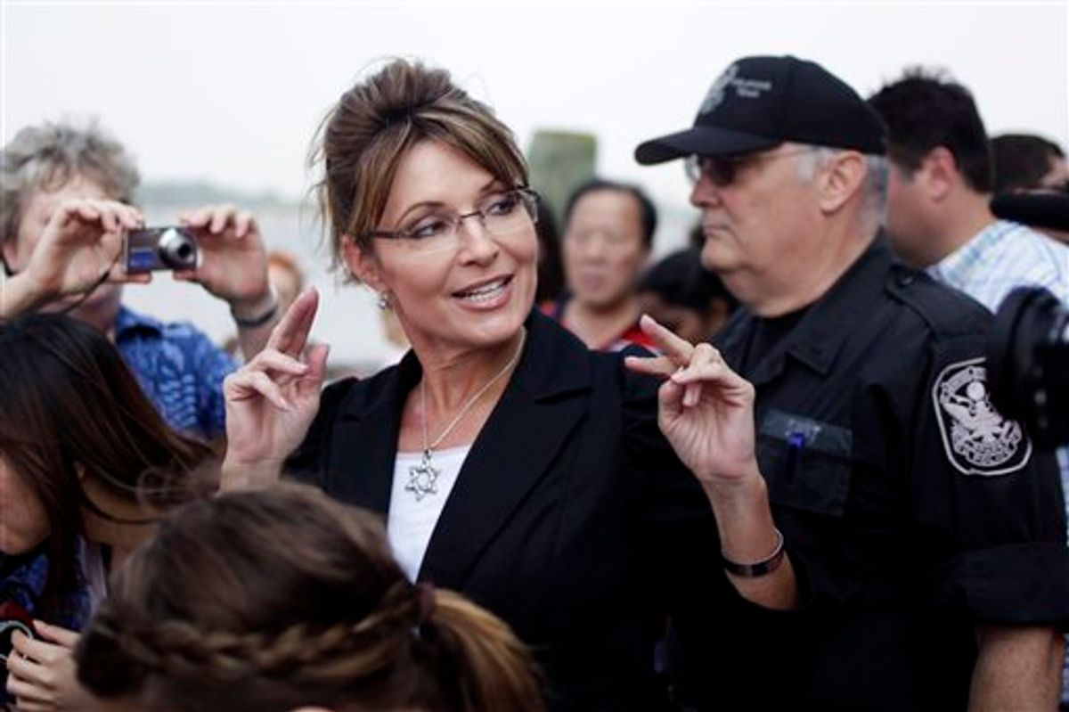 FILE - In this June 1, 2011 file photo, former Alaska Gov. Sarah Palin talks to the media as she leaves Liberty Island in New York.  Palin will visit Iowa, Tuesday, June 28, to attend the premiere of a documentary about her time as governor and her ascent as a national political figure.  (AP Photo/Seth Wenig, File) (AP)