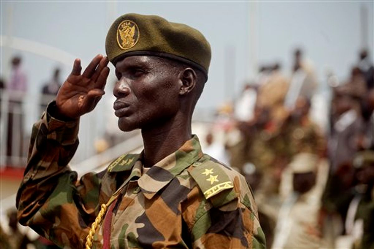 A Southern Sudanese soldiers stands at attention during the national anthem during an independence rehearsal procession in Juba, southern Sudan on Thursday, July 7, 2011. The Government of Southern Sudan is making lavish preparations to celebrate its declaration of independence from the north on Saturday, July 9th. The south's secession comes after decades of brutal civil war between north and south that resulted in more than two million deaths, most of which were southerners. (AP Photo/Pete Muller)  (AP)