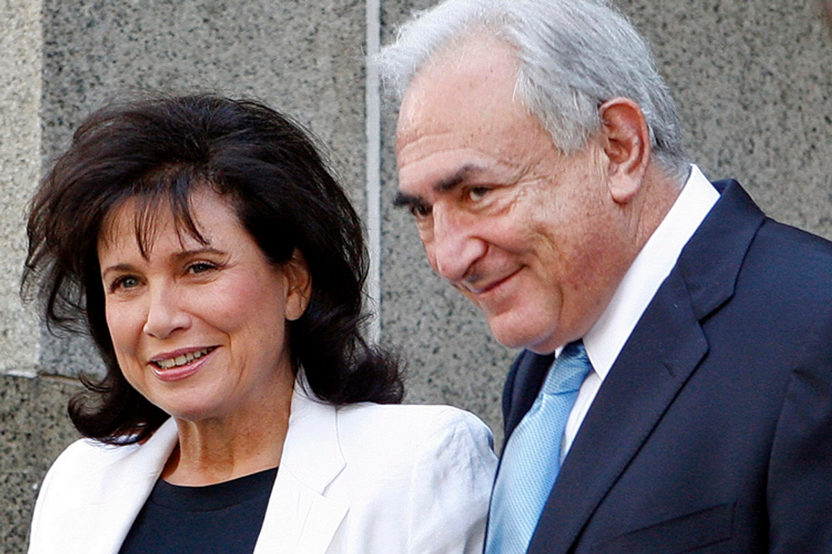 Former International Monetary Fund leader Dominique Strauss-Kahn leaves the New York State Supreme Court with his wife, Anne Sinclair, on July 1, 2011.