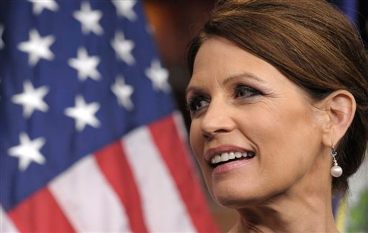 Republican presidential candidate, Rep. Michele Bachmann, R-Minn. takes part in a news conference on Capitol Hill in Washington, Wednesday, July 13, 2011. (AP Photo/Susan Walsh) (AP)