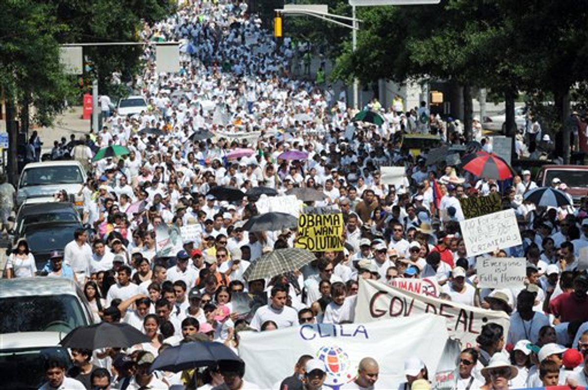 Thousands of people march through downtown Atlanta in protest against Georgia's strict new immigration law on Saturday, July 2, 2011 in Atlanta. On Monday, a Federal judge temporarily blocked parts of the law. One provision that was blocked authorizes police to check the immigration status of suspects without proper identification. It also authorizes them to detain illegal immigrants. (AP Photo/Erik S. Lesser)      (AP)
