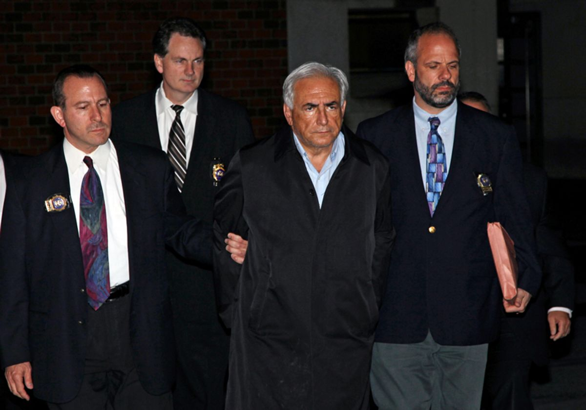 """FILE - In this May 15, 2011 file photo, Dominique Strauss-Kahn, head of the International Monetary Fund, is lead from a police station in New York where he was being held. While American authorities have condoned, or at least tolerated, such """"perp walks"""" for more than a century, in France it's been illegal to show images of suspects in handcuffs since 2000. French politicians and citizens alike are upset by the images, which they say make Strauss-Kahn, accused of sexual abuse, appear guilty. (AP Photo/Craig Ruttle, File) (Craig Ruttle)"""