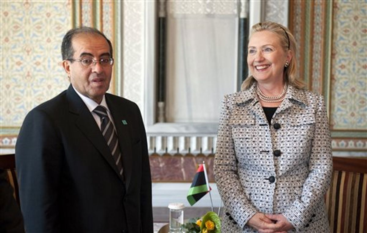 U.S Secretary of State Hillary Rodham Clinton reacts with Mahmud Jibril, Chairman of the Libyan Interim National Transitional Council, during the fourth Libya Contact Group Meeting in Istanbul, Friday, July 15, 2011. Around 15 top diplomats including US Secretary of State Hillary Rodham Clinton are to meet in Istanbul to discuss a political solution to the conflict in Libya while co-ordinating aid for the rebels. (AP Photo/Saul Loeb, Pool) (AP)