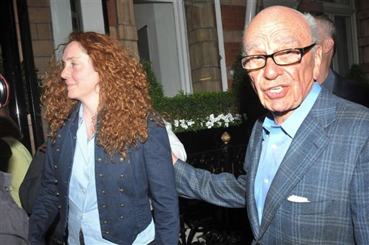 News International chief executive Rebekah Brooks, left, and Rupert Murdoch are seen outside the central London residence of News Corporation chairman Rupert Murdoch, Sunday July 10, 2011.  News Corp title News of the World newspaper ceased publication with today's issue, following accusations of alleged hacking into the mobile phones of various crime victims, celebrities and politicians. (AP Photo/Ian Nicholson, PA) UNITED KINGDOM OUT - NO SALES - NO ARCHIVES (AP)