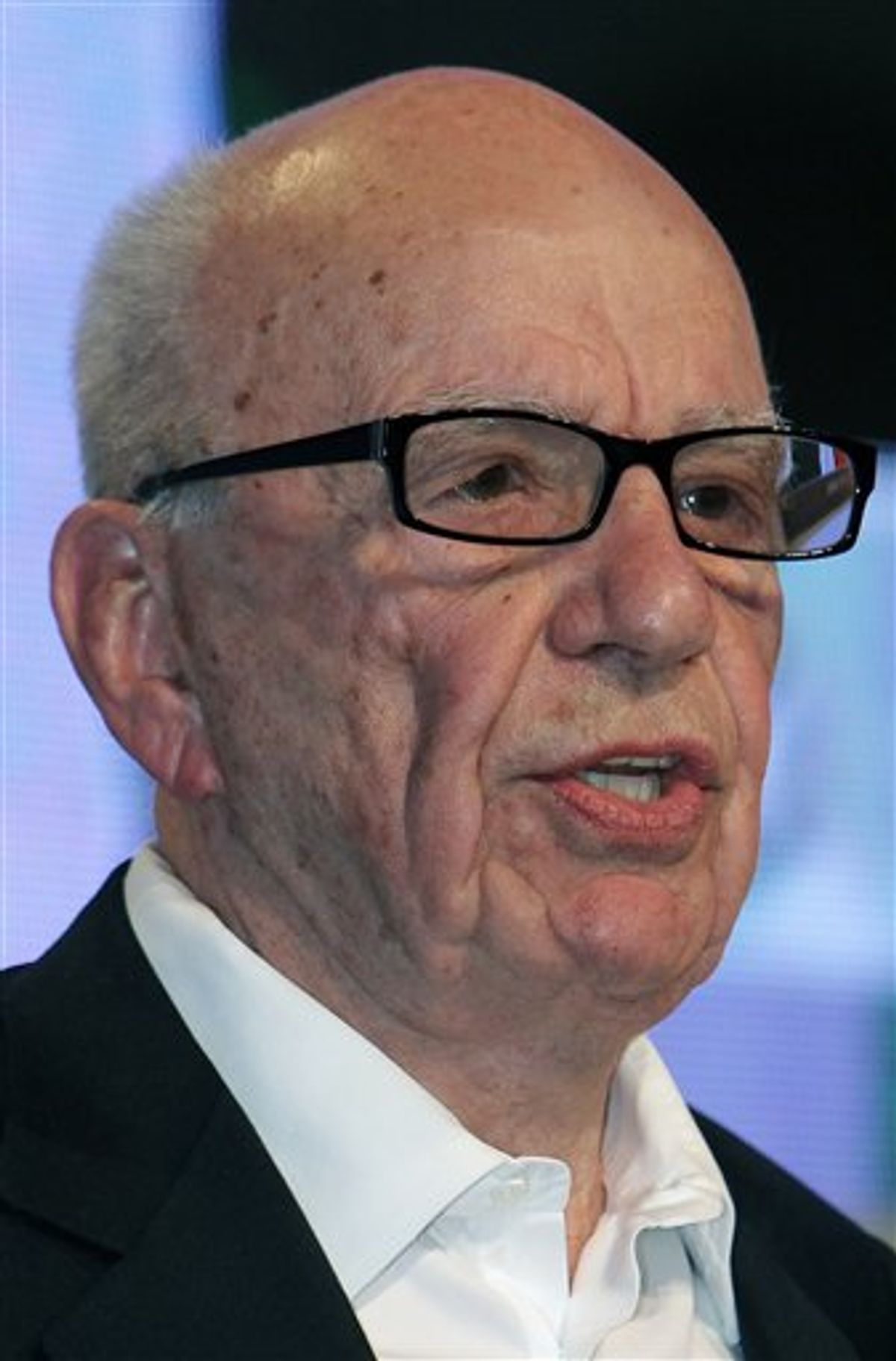 FILE - In this May 24, 2011 file photo, media magnate Rupert Murdoch speaks during the e-G8 conference, gathering Internet and information technologies leaders and experts, in Paris. Britain's prime minister demanded inquiries into a burgeoning phone hacking scandal as allegations mounted Wednesday, July 6, 2011, that a tabloid eavesdropped on missing schoolgirls and the families of terrorist bombing victims as well as celebrities and royals. The scandal poses a threat to Murdoch's global media empire, and is causing a growing number of companies to pull their ads from the News of the World tabloid in disgust. In addition, calls are mounting for Rebekah Brooks, Murdoch's top executive in Britain, to step down. (AP Photo/Bob Edme, File)  (AP)