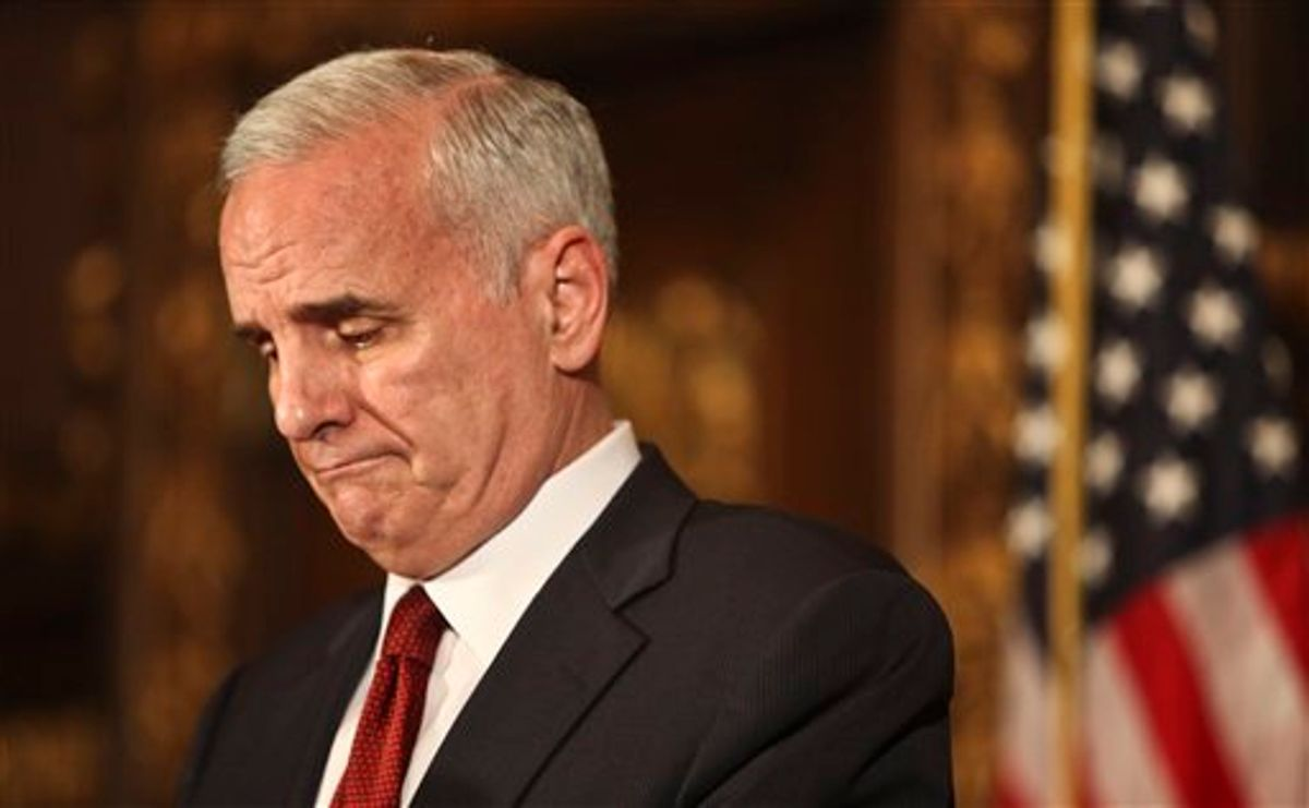 Gov. Mark Dayton addressed the media and some Republicans that were present as he said that the two sides were still not closeat the state capitol an hour left until a government shutdown. Minnesota state government shut down at 12:01 a.m. CDT Friday July 1, 2011 for the second time in six years after political leaders couldn't agree on how to solve a $5 billion budget deficit. (AP Photo Kyndell Harkness - STAR TRIBUNE) MANDATORY CREDIT   (AP)