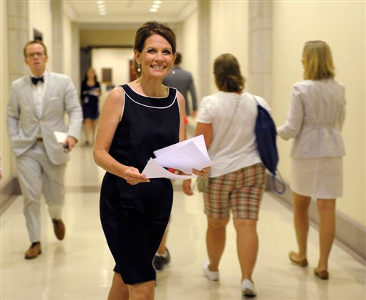 Republican presidential candidate, Rep. Michele Bachmann, R-Minn. heads to a news conference on Capitol Hill in Washington, Wednesday, July 13, 2011. (AP Photo/Susan Walsh)   (AP)