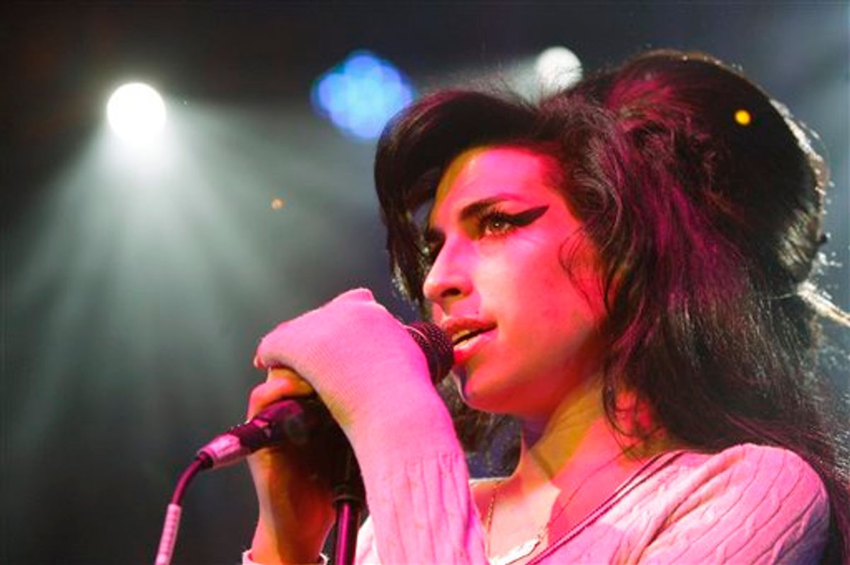 FILE - In this Oct. 25, 2007 file photo, British singer Amy Winehouse performs during her concert at the Volkshaus in Zurich, Switzerland. Winehouse was found dead Saturday, July 23, 2011, by ambulance crews who were called to her home in north London's Camden area. She was 27. (AP Photo/Keystone, Steffen Schmidt, File)    (AP)