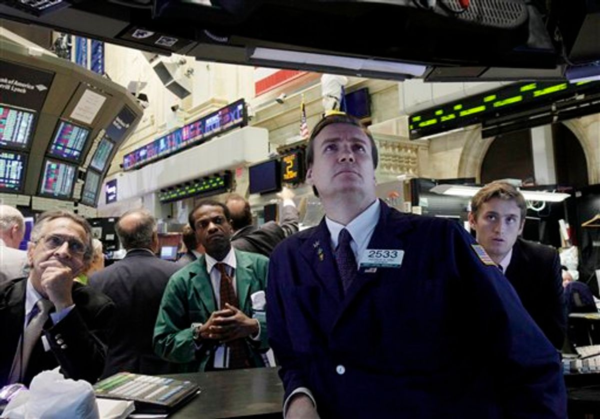 Specialist Patrick King, second from right, and others watch President Barack Obama's remarks on a television monitor the floor of the New York Stock Exchange Tuesday, Aug. 2, 2011. The stock market stumbled again Tuesday and is on pace for its longest losing streak in two years.(AP Photo/Richard Drew) (AP)