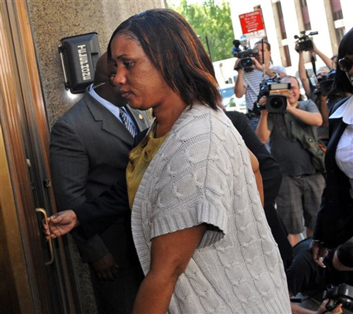 Hotel maid Nafissatou Diallo arrives at Manhattan criminal court for a meeting with New York City prosecutors investigating the sex assault case against Dominique Strauss-Kahn Wednesday, July 27, 2011, in New York. Diallo broke her silence in recent days with interviews in Newsweek and on a series of ABC News programs.  (AP Photo/ Louis Lanzano) (AP)
