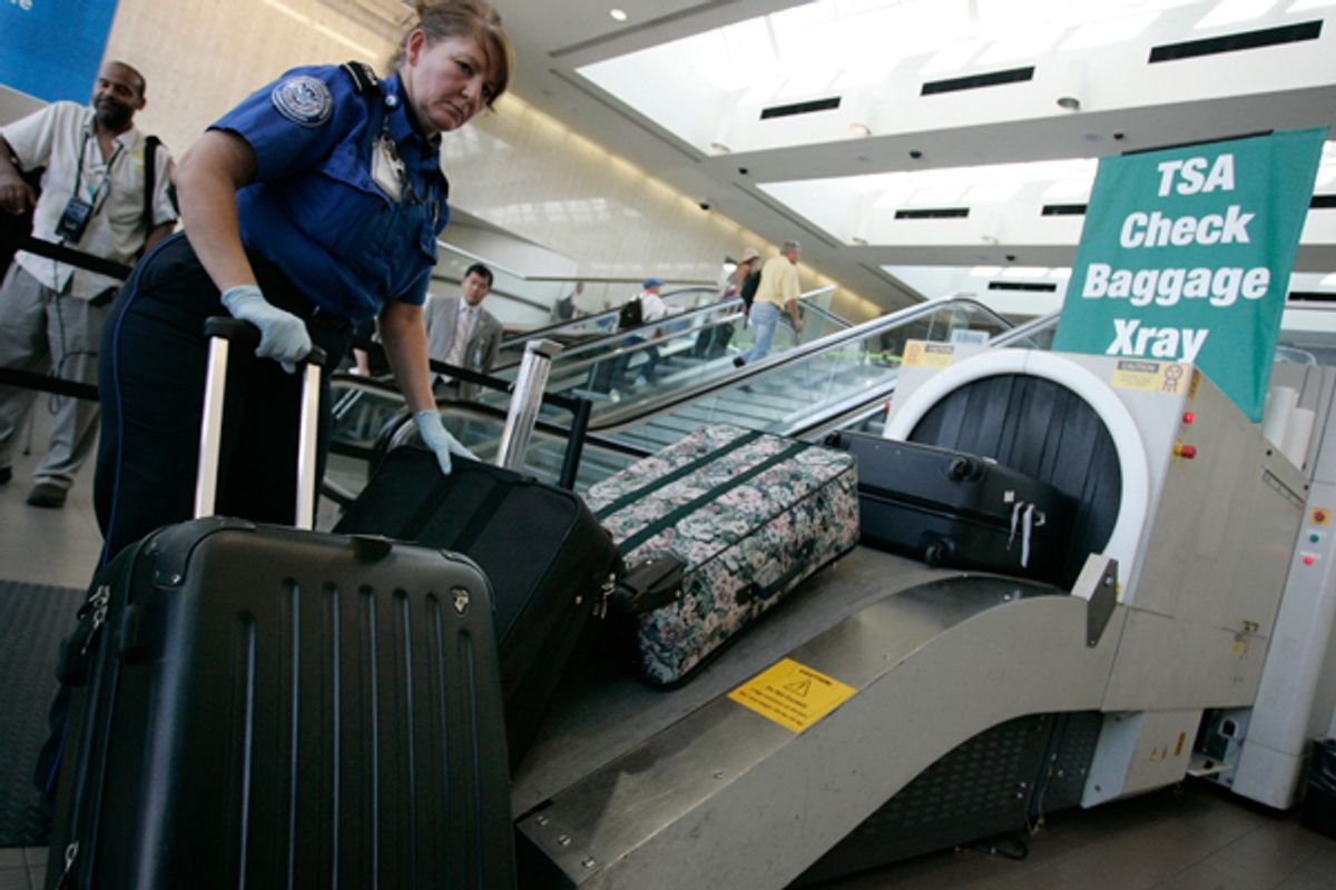 In this Aug. 3, 2011 photo, airline passengers go through the Transportation Security Administration security checkpoint at Hartsfield-Jackson Atlanta International Airport, in Atlanta. The TSA was created after the terrorist attacks of Sept. 11, 2001. (AP Photo/Erik S. Lesser) (AP)