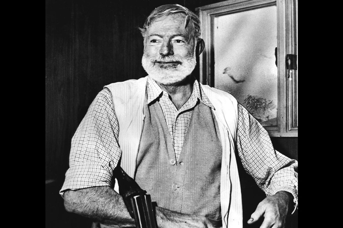 Ernest Hemingway, cradling a shotgun.