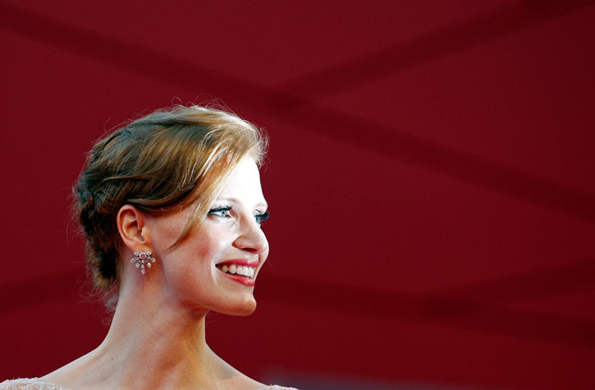 """Actress Jessica Chastain of the U.S. poses for photographers as she arrives on the """"Wilde Salome"""" red carpet at the 68th Venice Film Festival September 4, 2011. REUTERS/Alessandro Bianchi (ITALY - Tags: ENTERTAINMENT PROFILE TPX IMAGES OF THE DAY)   (Reuters)"""