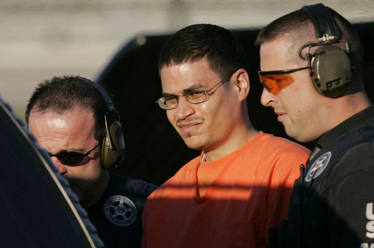 ** TO GO WITH PADILLA JUICIO ** **  FILE  **  Jose Padilla, center, is escorted to a waiting police vechicle by federal marshals near downtown Miami in this Jan. 5, 2006, file photo. The Bush administration's decision to charge alleged al-Qaida operative Jose Padilla in civilian court resolved one major legal challenge to the president's ability to hold people without charge in the war on terror. But things have not gone smoothly since, with Padilla and his defendants filing dozens of motions seeking access to government secrets and overseas terror detainees and poking holes in the evidence itself. Trial has already been delayed once and now, four months before the case is supposed to go before a jury, it appears to be anything but a slam dunk for the government. (AP Photo/J. Pat Carter) (Associated Press)