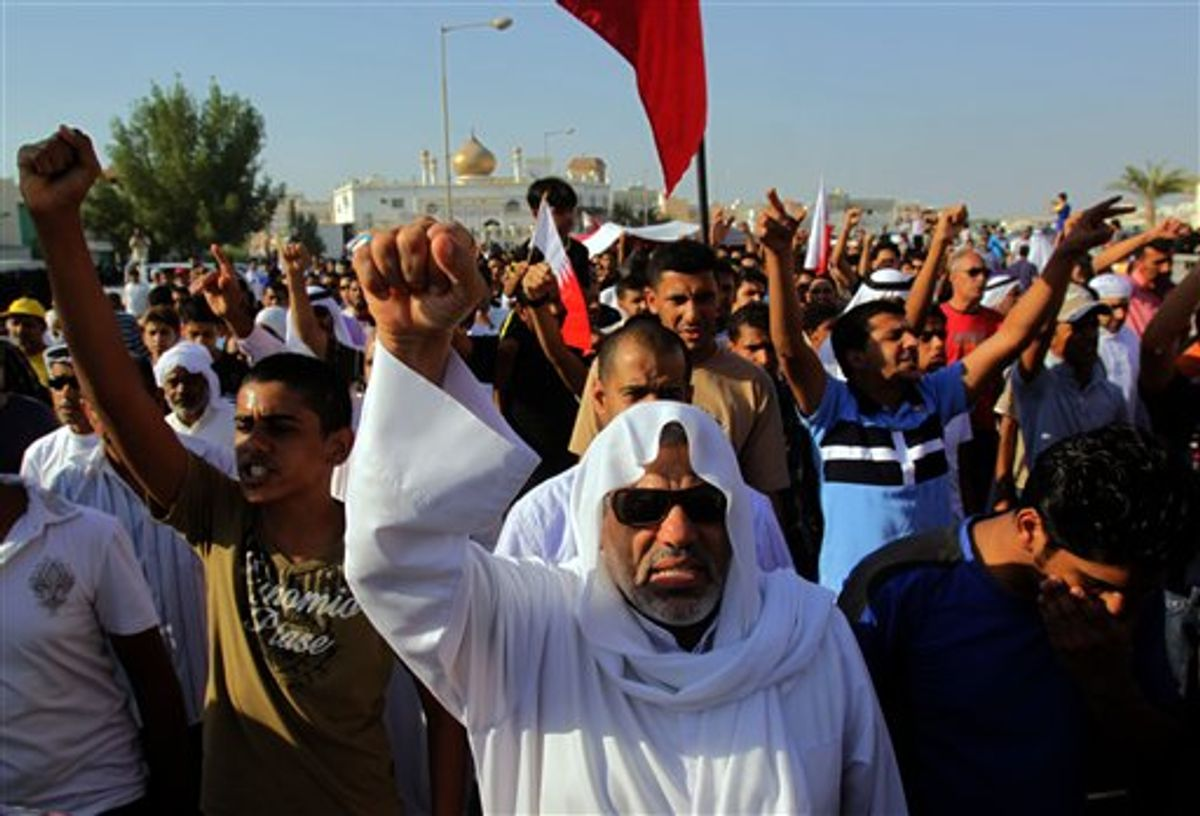 Thousands chant anti-government slogans Sunday, Sept. 18, 2011, in the western village of Dumistan, Bahrain, during the funeral of Jaffar Hasan Yousef, 29, who relatives said had been hospitalized in Bahrain and Jordan since being severely beaten during a house raid allegedly by security forces during the spring crackdown that followed an anti-government uprising. There was no immediate government comment. (AP Photo/Hasan Jamali) (AP Photo/Hasan Jamali)