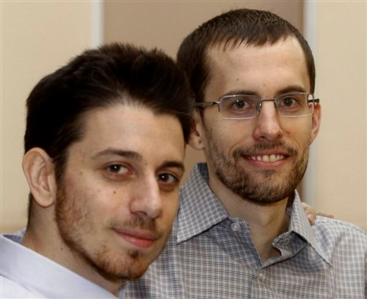 In this photo released by the Islamic Republic News Agency, IRNA, on Wednesday, Sept. 21, 2011, US hikers Shane Bauer, right, and Josh Fattal, smile, at the Tehran's Mehrabad airport before leaving Iran. Two Americans jailed in Iran as spies left Tehran on Wednesday, closing a high-profile drama with archfoe Washington that brought more than two years of hope then heartbreak for the families as the Islamic Republic's hard-line rulers rejected international calls for their release. (AP Photo/IRNA, Ehsan Nederipour) (AP Photo/IRNA, Ehsan Nederipour)