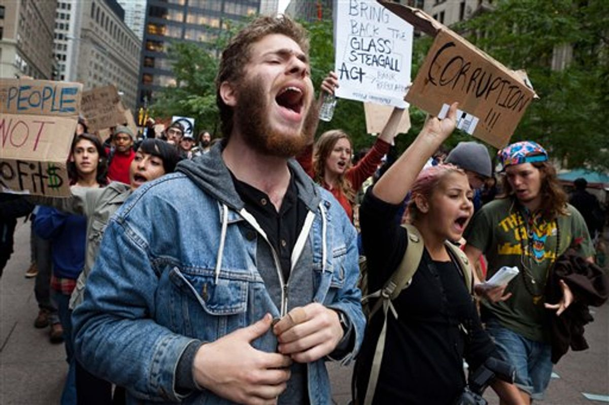A few hundred demonstrators protesting against corporations march from nearby Zucotti park to Wall Street, Tuesday, Sept. 20, 2011, in the Manhattan borough of New York. The demonstrators, who have been camping overnight in the park since Saturday, have been surrounded by police officers around the clock with at least 12 protestors arrested in recent days. (AP Photo/John Minchillo) (AP Photo/John Minchillo)