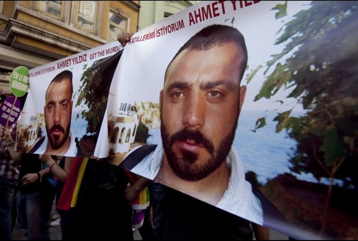 """Demonstrators tried to raise awareness of the 2008 murder of Ahmet Yildiz (""""Get the Murderers"""" is written above the victim's photo) during a gay pride march in Istanbul on June 26, 2011  (Jodi Hilton/GlobalPost)"""