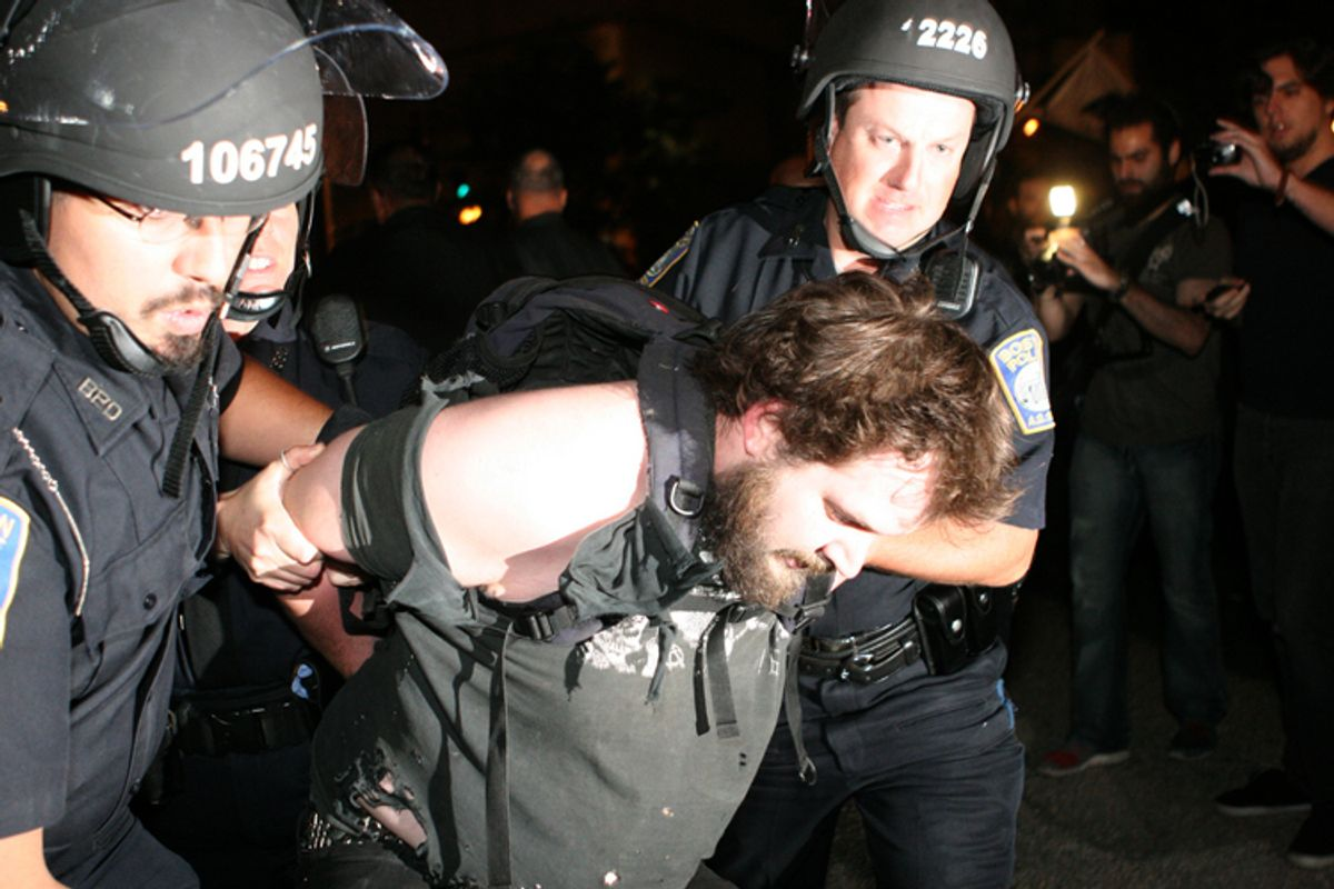 Boston Police arrest a demonstrator on Oct. 10, 2011.    (<span about='http://www.flickr.com/photos/31167233@N08/6234070462/' xmlns:cc='http://creativecommons.org/ns#'><a href='http://www.flickr.com/photos/31167233@N08/6234070462/' rel='cc:attributionURL' target='_blank'>Paul Weiskel</a> / <a href='http://creativecommons.org/licenses/by/3.0/' rel='license' target='_blank'>CC BY 3.0</a></span>)