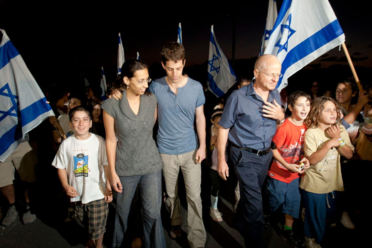 Noam Schalit, right, Yoel Schalit and Yaara Winkler, father and brother of captured Israeli soldier Gilad Schalit walk with family and friends to their home in Mitzpe Hila, northern Israel, Wednesday, Oct. 12, 2011.    (AP)