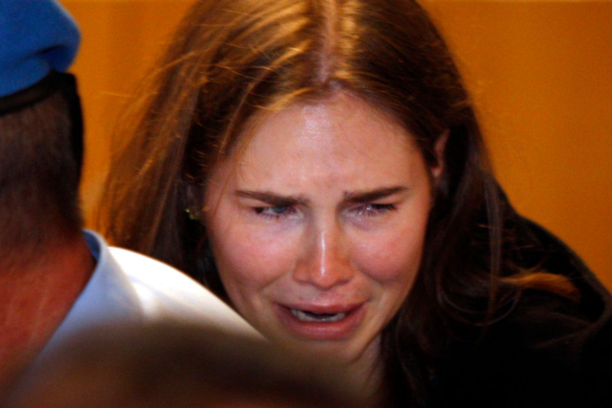 Amanda Knox breaks in tears after hearing the verdict that overturns her conviction and acquits her of murdering her British roommate Meredith Kercher, Monday, Oct. 3, 2011.                (AP/Pier Paolo Cito)