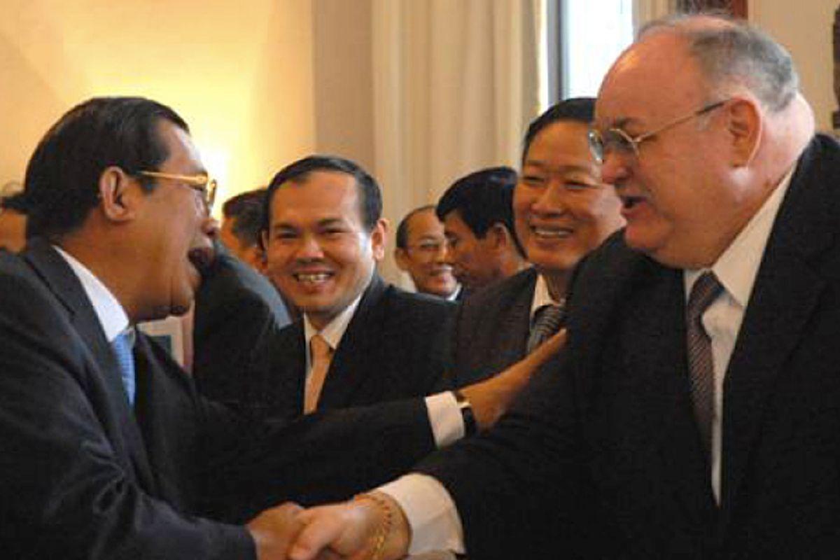Bretton Sciaroni, right, shakes hands with Cambodian prime minister Hun Sen