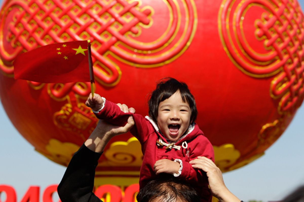 A child poses in front of a giant red lantern on display at Beijing's Tiananmen Square on China's National Day.           (Reuters/Jason Lee)