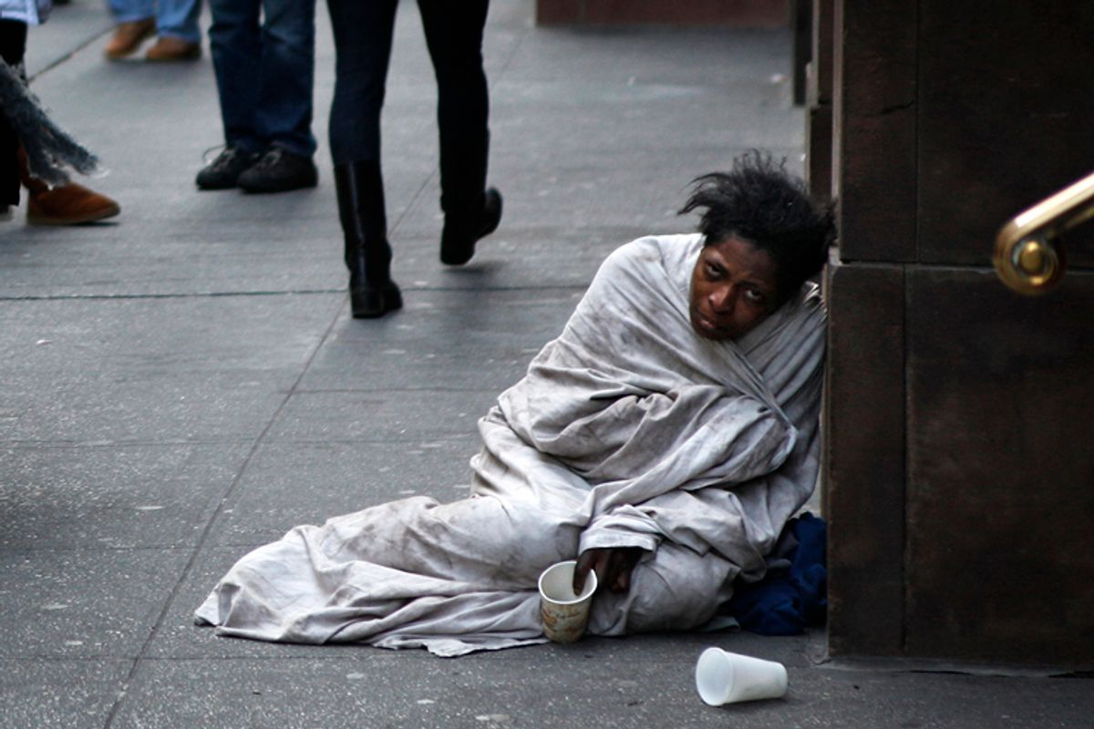 A panhandler begs for money on Fifth Avenue in New York December 8, 2009    (Finbarr O'reilly / Reuters)