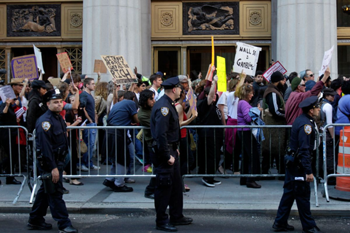 Police escort Occupy Wall Street protesters marching in New York on Wednesday.      (AP/Seth Wenig)