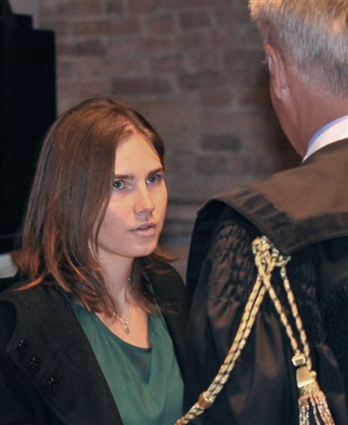 Amanda Knox talks with her lawyer Carlo Dalla Vedova upon arrival for an appeal hearing at the Perugia court, central Italy, Monday, Oct. 3, 2011.        (AP Photo/Antonio Calanni)