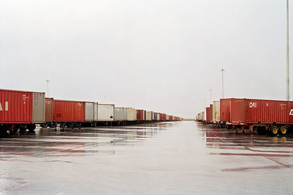 Untitled (Red containers, wet ground), Fort Worth, Texas, 2000.    (Collection Lannan Foundation)