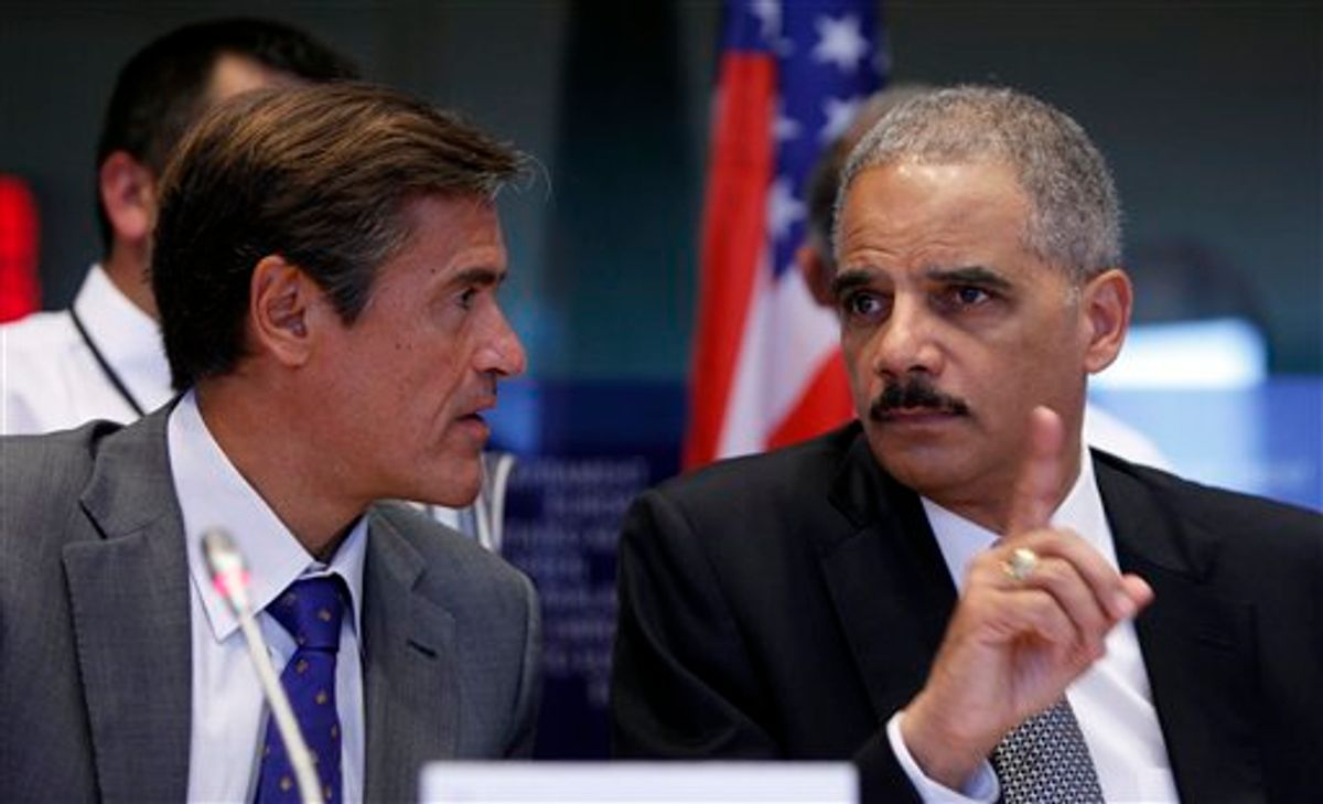 Spanish MEP Juan Fernandez Aguilar, left, looks on as United States Attorney General Eric Holder, right, speaks during a session at the European Parliament in Brussels on Tuesday, Sept. 20, 2011.          (AP/Virginia Mayo)
