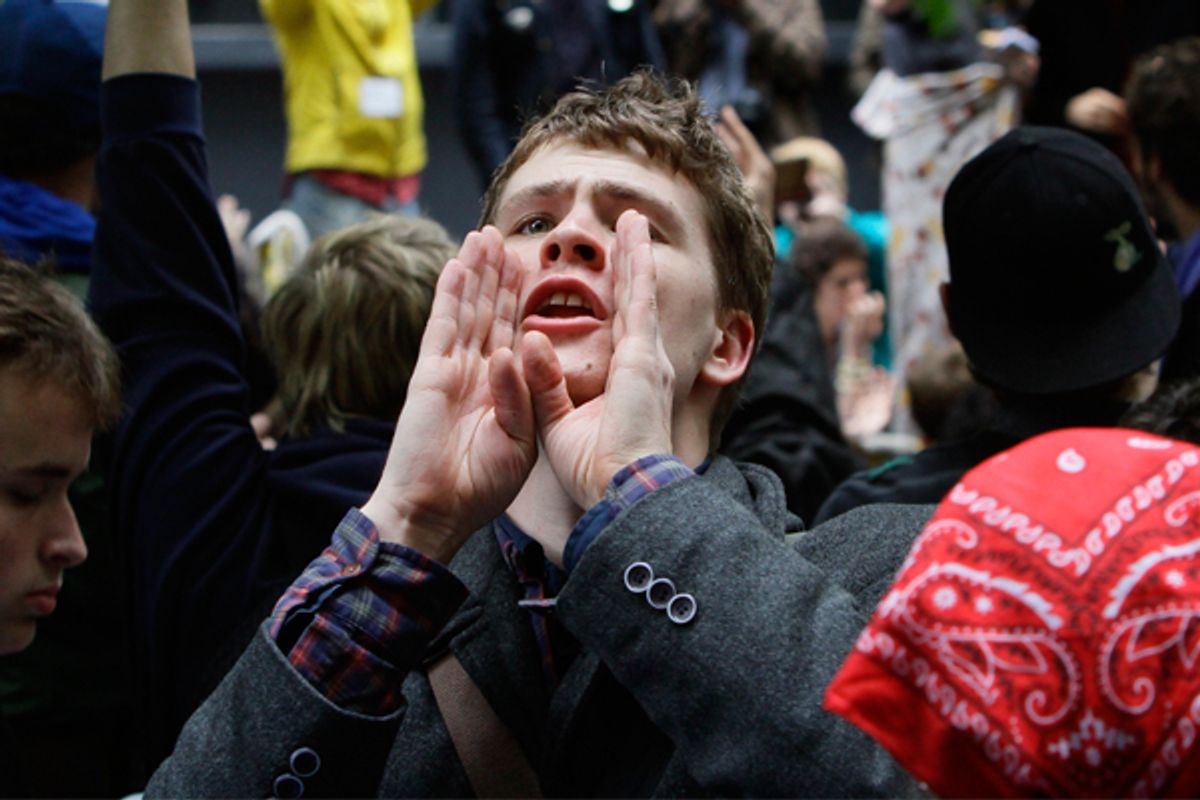 A protestor takes on the role of a human microphone, relaying information throughout Zuccotti Park's Occupy Wall Street encampment.   (AP/Bebeto Matthews)
