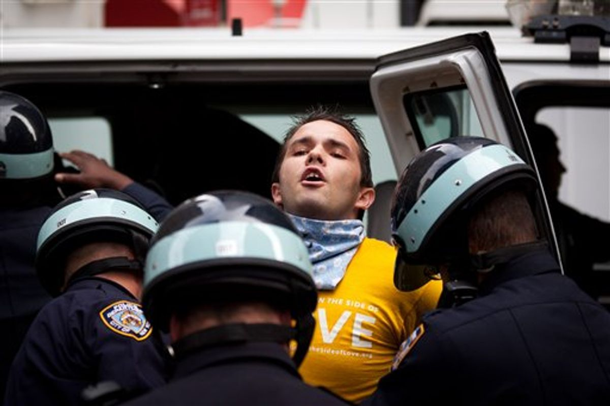 Occupy Wall Street protestor Lincoln Statler is arrested along with several others in the financial district's Zucotti park, Monday, Oct. 3, 2011.   (AP Photo/John Minchillo)
