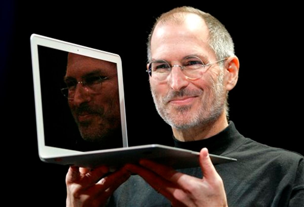 Apple CEO Steve Jobs holds up the new MacBook Air after giving the keynote address at the Apple MacWorld Conference in San Francisco in 2008.     (AP Photo/Jeff Chiu, File)