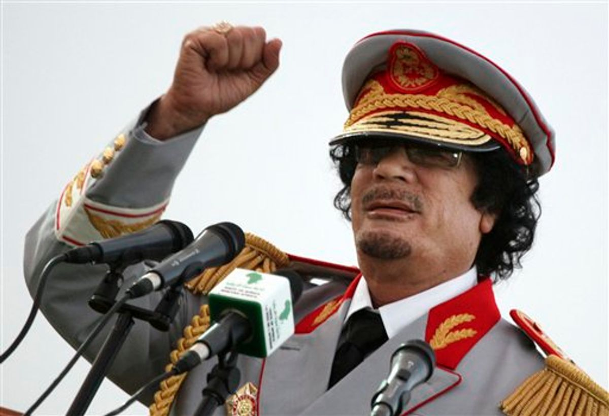 In this Saturday, June 12, 2010 file photo, Libyan leader Moammar Gadhafi talks during a ceremony to mark the 40th anniversary of the evacuation of the American military bases in the country, in Tripoli, Libya.   (AP Photo/ Abdel Magid Al Fergany, File)