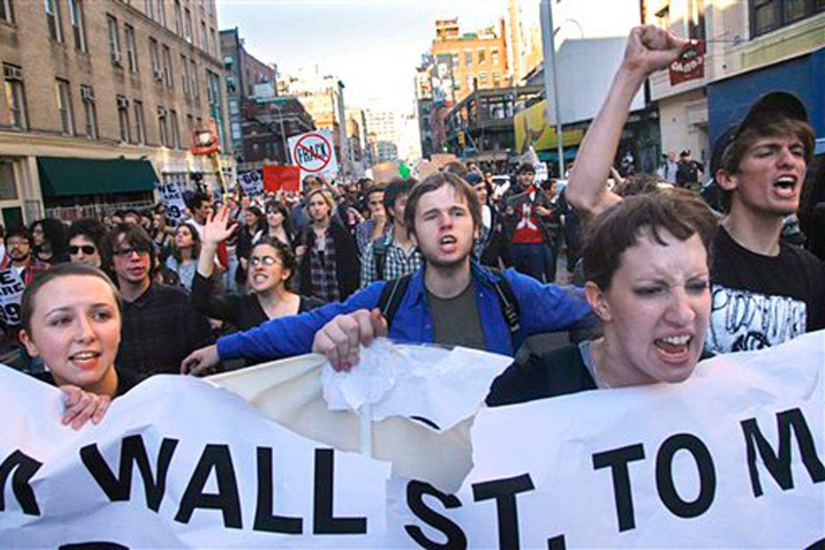 A coalition of students and their supporters from New York University and The New School chant march towards Zuccotti Park in lower Manhattan in New York       (AP/Bebeto Matthews)