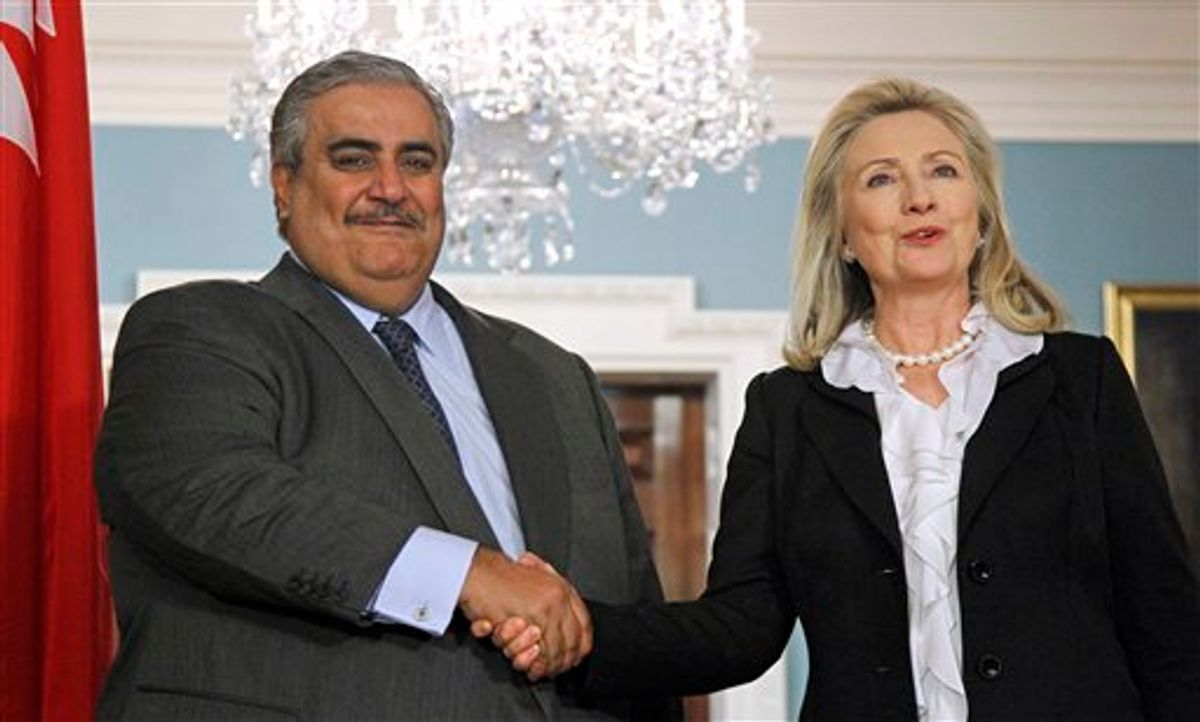 Secretary of State Hillary Rodham Clinton shakes hands with Bahrain's Foreign Minister Shaikh Khalid bin Ahmed al-Khalifa after delivering a statement, Wednesday, Oct. 26, 2011, at the State Department in Washington.     (AP Photo/Haraz N. Ghanbari)