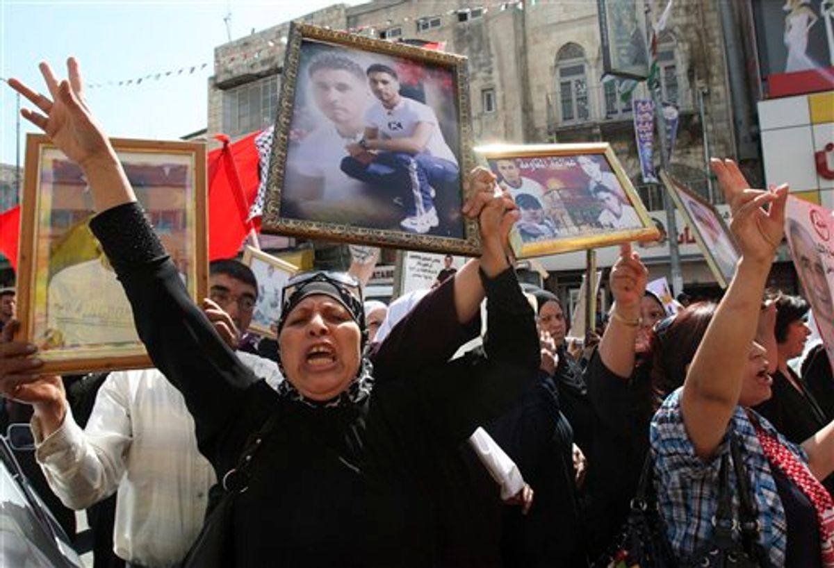 Palestinians participate in a demonstration in solidarity with prisoners jailed in Israel in the West Bank city of Nablus, Tuesday Oct. 11, 2011.    (AP/Nasser Ishtayeh)