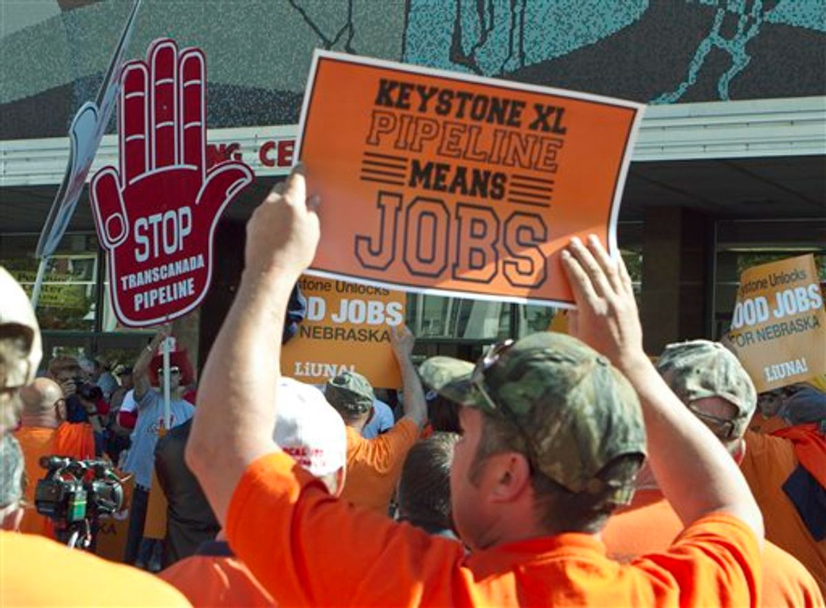 Demonstrators for and against the Keystone XL pipeline gather outside Pershing Auditorium near the state Capitol in Lincoln, Neb., Tuesday, Sept. 27, 2011.  (AP/Nati Harnik)