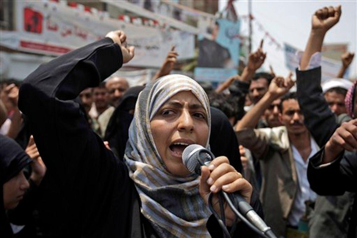 Yemeni activist Tawakkul Karman chants slogans along with anti-government protestors, during a demonstration demanding the resignation of Yemeni President Ali Abdullah Saleh, in Sanaa, Yemen, in June.      (AP/Hani Mohammed)