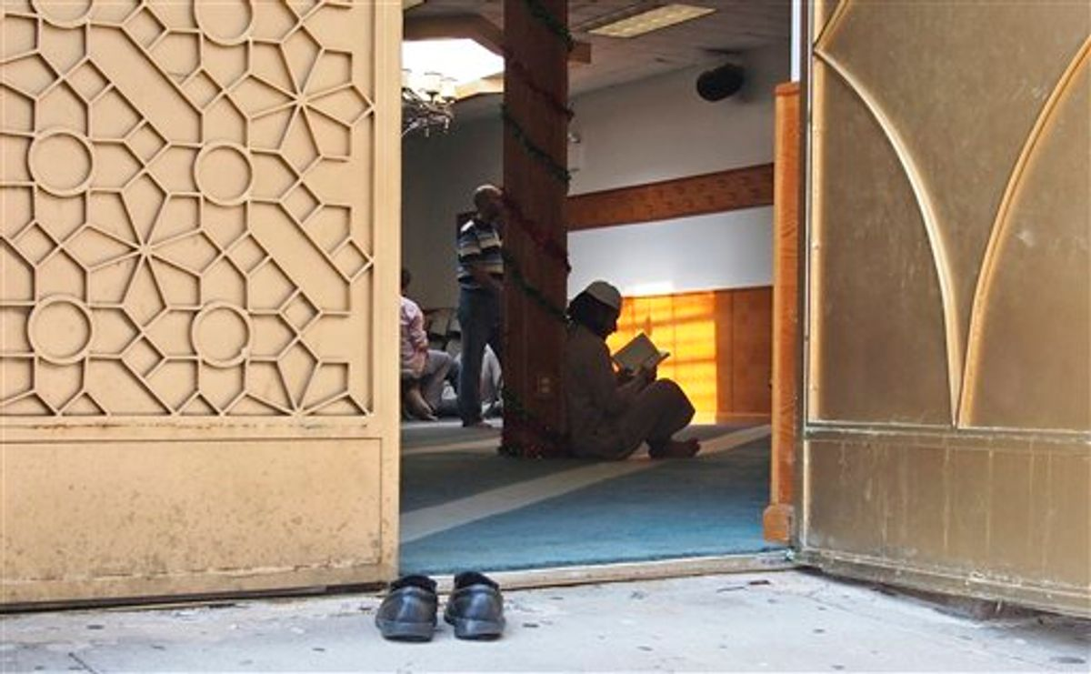 In this photo taken Sept. 2, 2011, worshippers are pictured inside the Al-Iman Mosque after midday prayers in the Astoria neighborhood of the Queens borough of New York.         (AP Photo/Charles Dharapak)